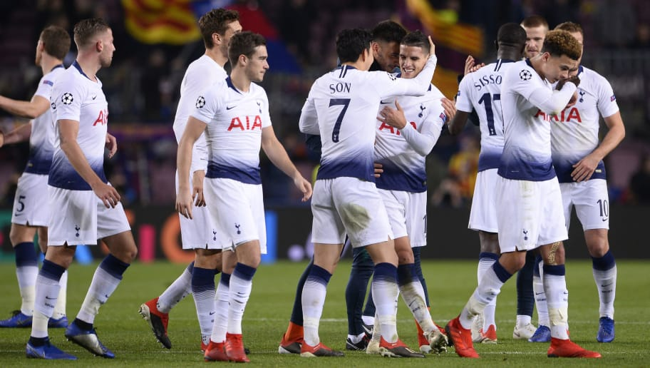 Tottenham Hotspur players celebrate their qualification for the next round during the UEFA Champions League group B football match between FC Barcelona and Tottenham Hotspur at the Camp Nou stadium in Barcelona on December 11, 2018. (Photo by Josep LAGO / AFP)        (Photo credit should read JOSEP LAGO/AFP/Getty Images)
