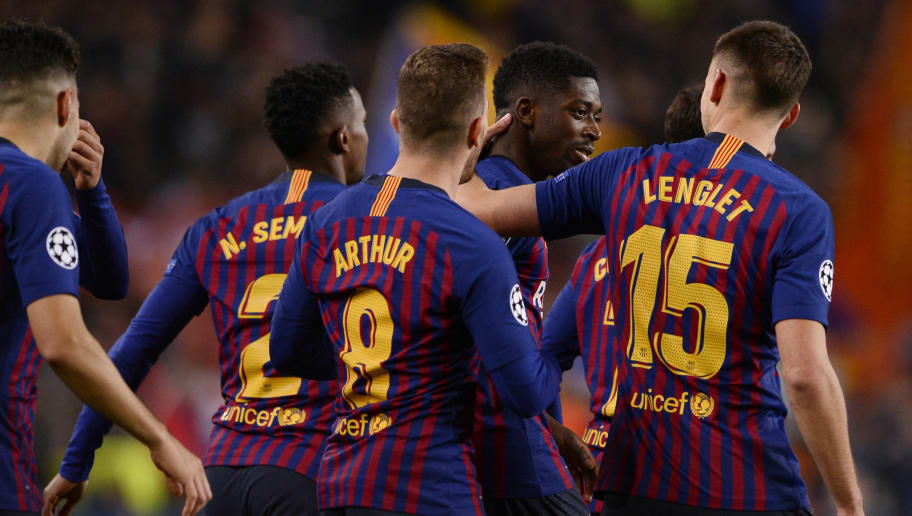 Barcelona's French forward Ousmane Dembele (2R) is congratulated by teammates after scoring a goal during the UEFA Champions League group B football match between FC Barcelona and Tottenham Hotspur at the Camp Nou stadium in Barcelona on December 11, 2018. (Photo by Josep LAGO / AFP)        (Photo credit should read JOSEP LAGO/AFP/Getty Images)
