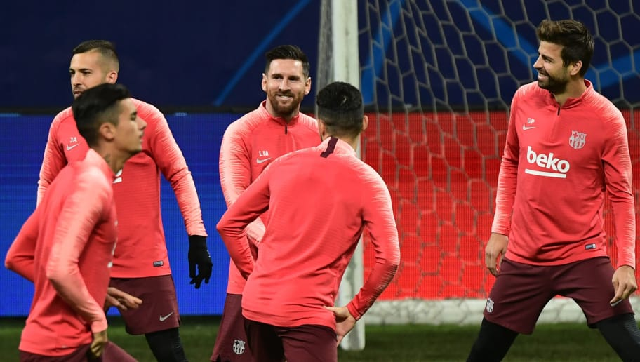 Barcelona's Argentinian forward Lionel Messi (C) jokes with Barcelona's Spanish defender Jordi Alba (L) and Barcelona's Spanish defender Gerard Pique (R) during a training session on November 5, 2018 at San Siro stadium, on the eve of the UEFA Champions League group B football match Inter Milan vs Barcelone. (Photo by Miguel MEDINA / AFP)        (Photo credit should read MIGUEL MEDINA/AFP/Getty Images)