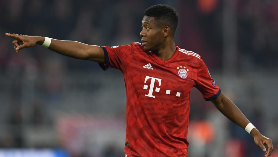 Bayern Munich's Austrian defender David Alaba gestures during the UEFA Champions League Group E football match Bayern Munich v AEK Athens FC in Munich, southern Germany, on November 7, 2018. (Photo by Christof STACHE / AFP)        (Photo credit should read CHRISTOF STACHE/AFP/Getty Images)