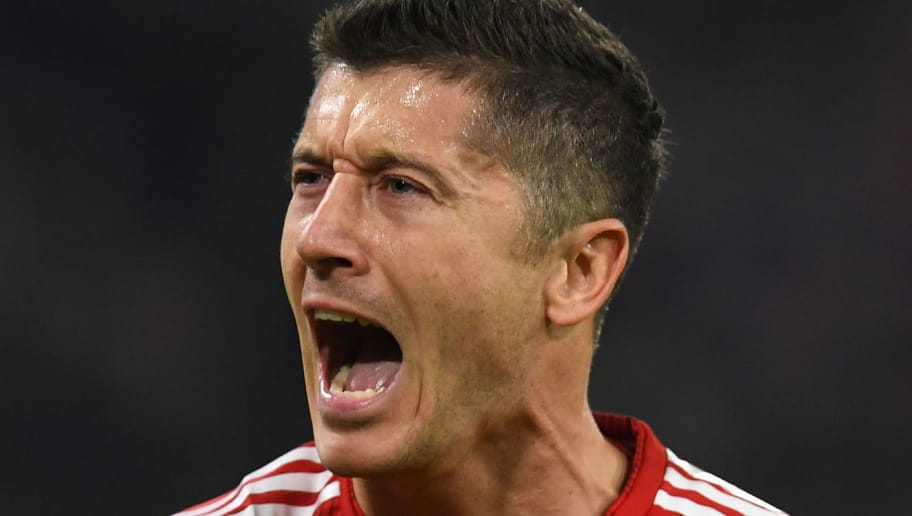 Bayern Munich's Polish forward Robert Lewandowski celebrates scoring the opening goal during the UEFA Champions League Group E football match Bayern Munich v AEK Athens FC in Munich, southern Germany, on November 7, 2018. (Photo by Christof STACHE / AFP) / ALTERNATIVE CROP        (Photo credit should read CHRISTOF STACHE/AFP/Getty Images)