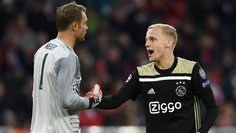 Bayern Munich's German goalkeeper Manuel Neuer and Ajax's Dutch midfielder Donny Van de Beek shake hands during the UEFA Champions League Group E football match between Bayern Munich and Ajax Amsterdam in Munich, southern Germany, on October 2, 2018. (Photo by Christof STACHE / AFP)        (Photo credit should read CHRISTOF STACHE/AFP/Getty Images)