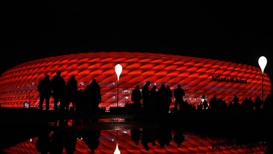 Spectators walk outside the stadium ahead the UEFA Champions League group D football match FC Bayern Munich vs PSV Eindhoven in Munich, on October 19, 2016.  / AFP / CHRISTOF STACHE        (Photo credit should read CHRISTOF STACHE/AFP/Getty Images)