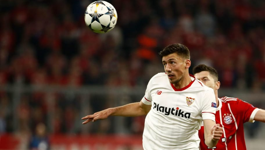 Sevilla's French defender Clement Lenglet (L) vies with Bayern Munich's Polish forward Robert Lewandowski during the UEFA Champions League quarter-final second leg football match between Bayern Munich and Sevilla FC on April 11, 2018 in Munich, southern Germany. / AFP PHOTO / Odd ANDERSEN        (Photo credit should read ODD ANDERSEN/AFP/Getty Images)
