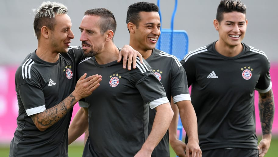(L-R) Bayern Munich's Brazilian defender Rafinha, French midfielder Franck Ribery, Spanish midfilder Thiago and Colombian midfielder James Rodriguez joke during a training session at the trainings ground of FC Bayern Munich in Munich, southern Germany, on April 24, 2018 on the eve of the UEFA Champions League first leg semi-final football match between Bayern Munich and Real Madrid. (Photo by Christof STACHE / AFP)        (Photo credit should read CHRISTOF STACHE/AFP/Getty Images)