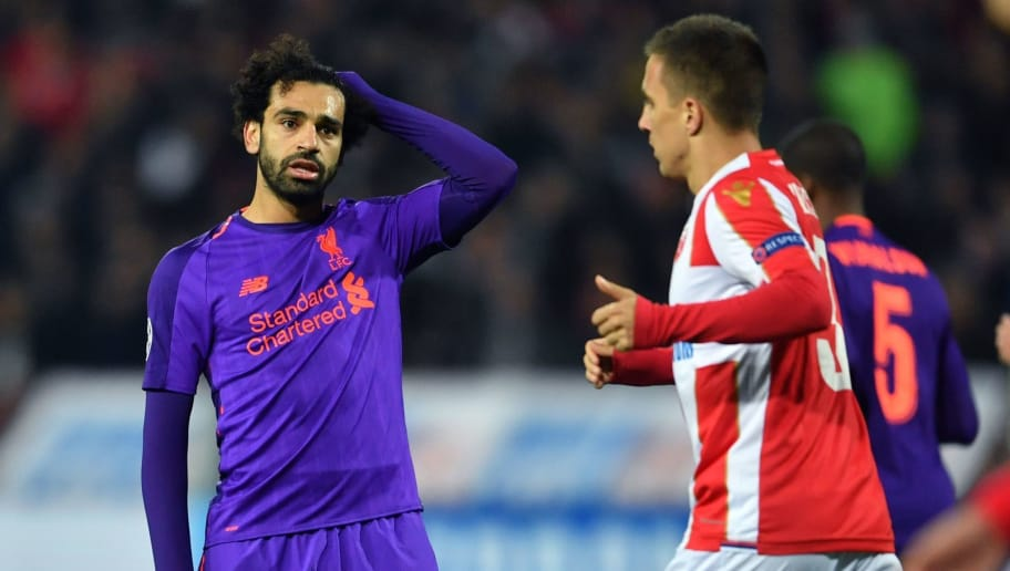 Liverpool's Egyptian forward Mohamed Salah (L) reacts  during the UEFA Champions League Group C second-leg football match between Red Star Belgrade and Liverpool FC at the Rajko Mitic Stadium in Belgrade on November 6, 2018. (Photo by Andrej ISAKOVIC / AFP)        (Photo credit should read ANDREJ ISAKOVIC/AFP/Getty Images)