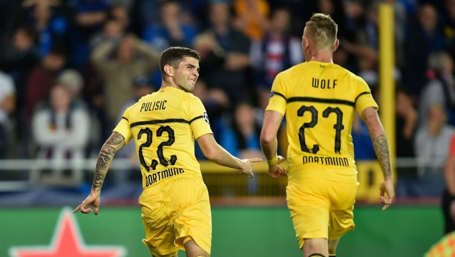 Dortmund's US midfielder Christian Pulisic (L) celebrates after scoring during the UEFA Champions League Group C football match Club Brugge vs Borussia Dortmund  at the Jan Breydel stadium in Bruges on September 18, 2018. (Photo by JOHN THYS / AFP)        (Photo credit should read JOHN THYS/AFP/Getty Images)
