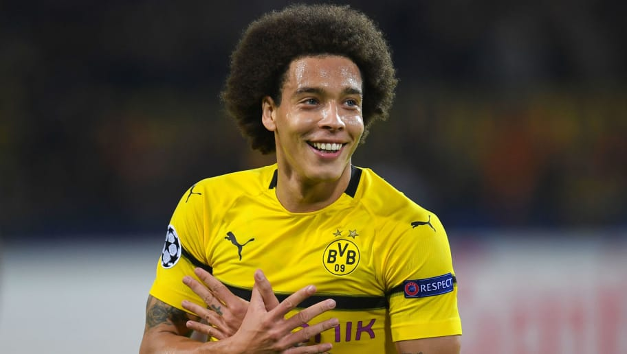 Dortmund's Belgian midfielder Axel Witsel celebrates scoring the opening goal during the UEFA Champions League group A football match BVB Borussia Dortmund v Atletico de Madrid in Dortmund, western Germany on October 24, 2018. (Photo by Patrik STOLLARZ / AFP) / ALTERNATIVE CROP        (Photo credit should read PATRIK STOLLARZ/AFP/Getty Images)