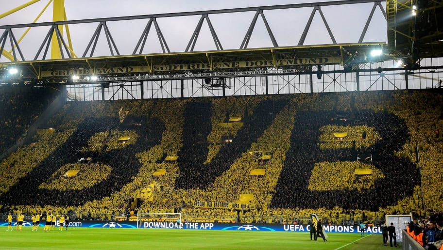 Dortmund's supporters choreograph their club's logo on the tribune during the UEFA Champions League 1st leg quarter-final football match BVB Borussia Dortmund v Monaco in Dortmund, western Germany on April 12, 2017. / AFP PHOTO / SASCHA SCHUERMANN        (Photo credit should read SASCHA SCHUERMANN/AFP/Getty Images)