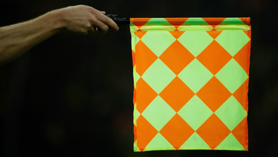The linesman holds his flag for offside during the UEFA Champions League Group A football match BVB Borussia Dortmund v AS Monaco in Dortmund, western Germany on October 3, 2018. (Photo by Odd ANDERSEN / AFP)        (Photo credit should read ODD ANDERSEN/AFP/Getty Images)