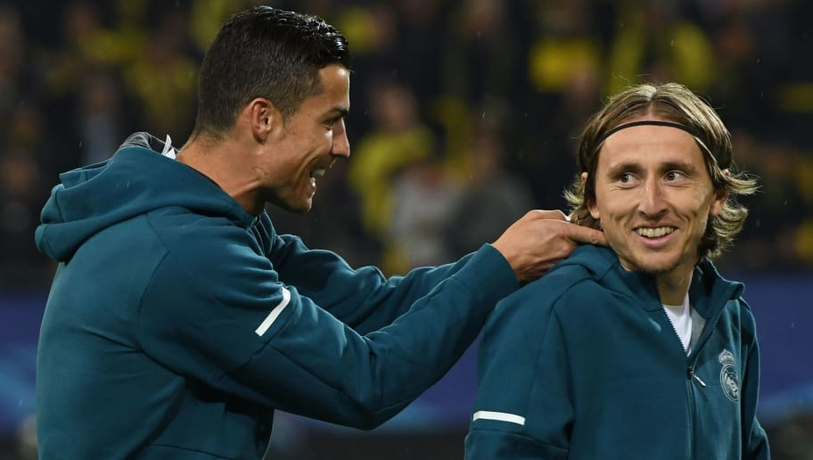 Real Madrid's forward from Portugal Cristiano Ronaldo (L) and Real Madrid's midfielder from Croatia Luka Modric joke around prior to the UEFA Champions League Group H football match BVB Borussia Dortmund v Real Madrid in Dortmund, western Germany on September 26, 2017. / AFP PHOTO / Patrik STOLLARZ        (Photo credit should read PATRIK STOLLARZ/AFP/Getty Images)