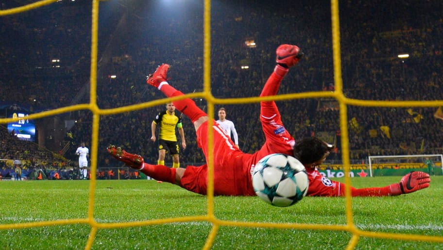 Tottenham Hotspur's English striker Harry Kane (not in picture) scores past Dortmund's Swiss goalkeeper Roman Buerki (front) during the UEFA Champions League Group H football match BVB Borussia Dortmund v Tottenham Hotspur at the BVB Stadion on November 21, 2017 in Dortmund, western Germany. / AFP PHOTO / John MACDOUGALL        (Photo credit should read JOHN MACDOUGALL/AFP/Getty Images)
