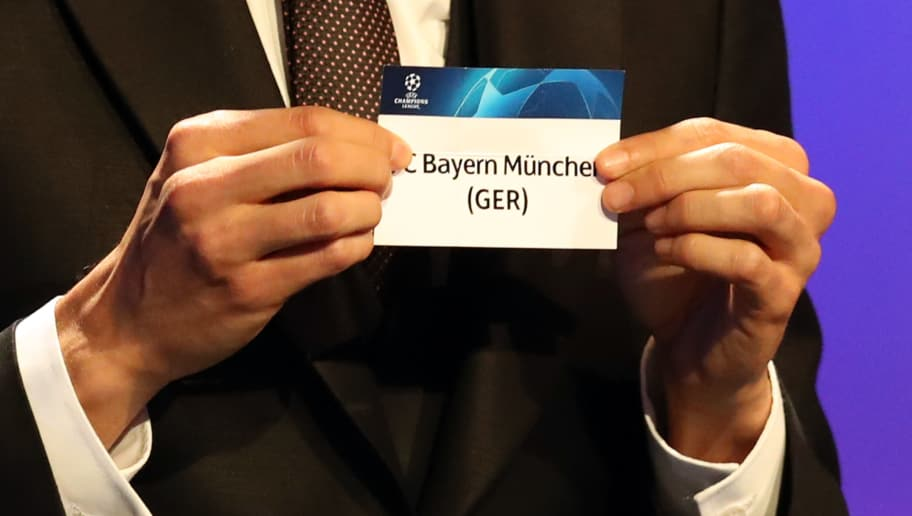 Brazilian former football player Kaka shows the name of Bayern Munich during the draw for UEFA Champions League football tournament at The Grimaldi Forum in Monaco on August 30, 2018. (Photo by Valery HACHE / AFP)        (Photo credit should read VALERY HACHE/AFP/Getty Images)