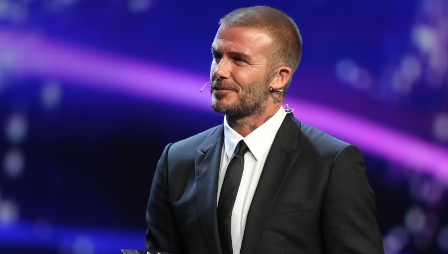 Former England's midfielder David Beckham reacts after receiving the UEFA President's Award ahead of the draw for UEFA Champions League football tournament at The Grimaldi Forum in Monaco on August 30, 2018. (Photo by Valery HACHE / AFP)        (Photo credit should read VALERY HACHE/AFP/Getty Images)