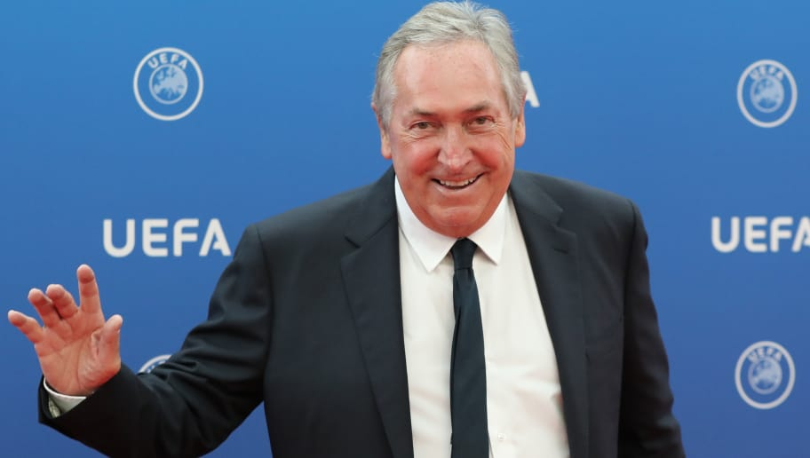 Olympique Lyonnais advisor Gerard Houllier arrives to attend the draw for UEFA Champions League football tournament at The Grimaldi Forum in Monaco on August 30, 2018. (Photo by Valery HACHE / AFP)        (Photo credit should read VALERY HACHE/AFP/Getty Images)