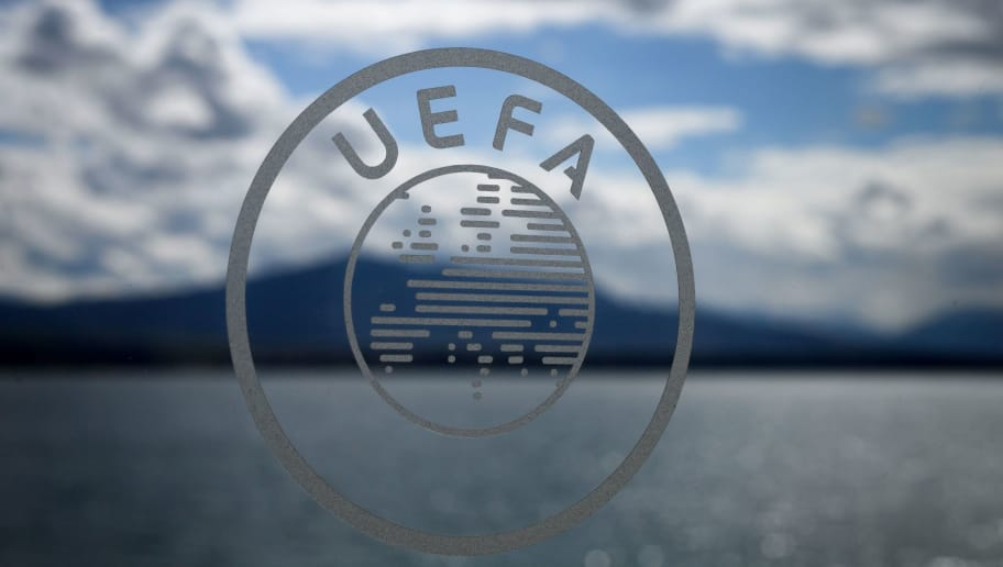 The UEFA logo is seen during the draw for the semi-finals round of the UEFA Champions League football tournament at the UEFA headquarters in Nyon on April 13, 2018.  / AFP PHOTO / Fabrice COFFRINI        (Photo credit should read FABRICE COFFRINI/AFP/Getty Images)
