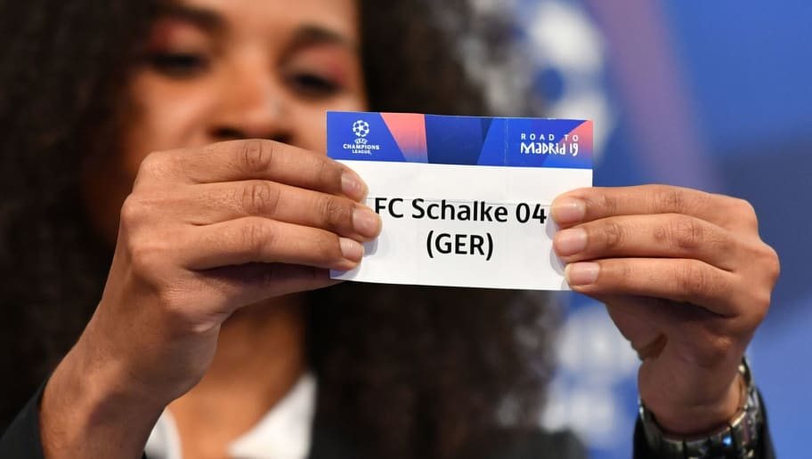 Former French football player Laura Georges shows the slip of FC Schalke during the draw for the round of 16 of the UEFA Champions League football tournament at the UEFA headquarters in Nyon on December 17, 2018. (Photo by Fabrice COFFRINI / AFP)        (Photo credit should read FABRICE COFFRINI/AFP/Getty Images)