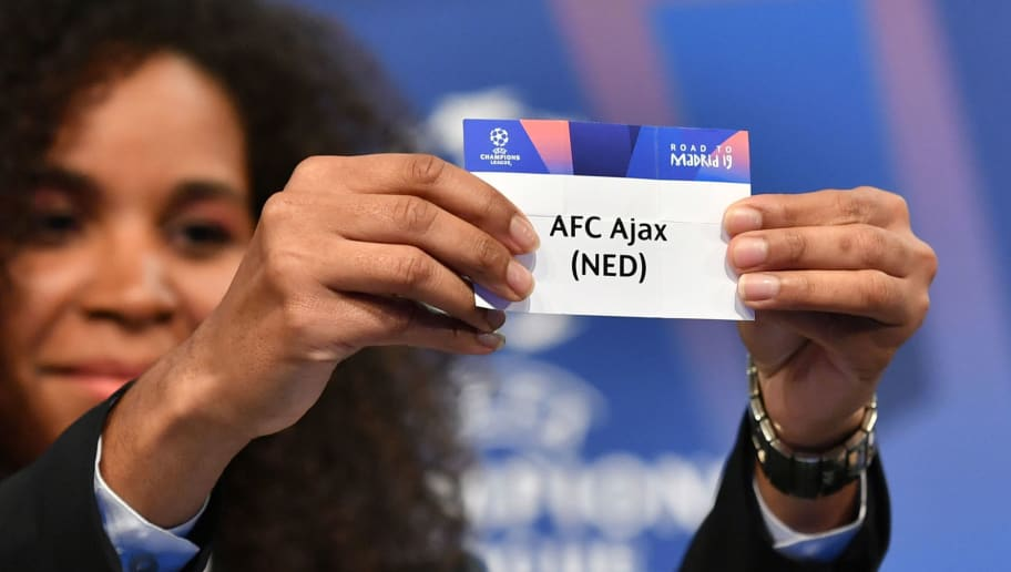 Former French football player Laura Georges shows the slip of AFC Ajax during the draw for the round of 16 of the UEFA Champions League football tournament at the UEFA headquarters in Nyon on December 17, 2018. (Photo by Fabrice COFFRINI / AFP)        (Photo credit should read FABRICE COFFRINI/AFP/Getty Images)
