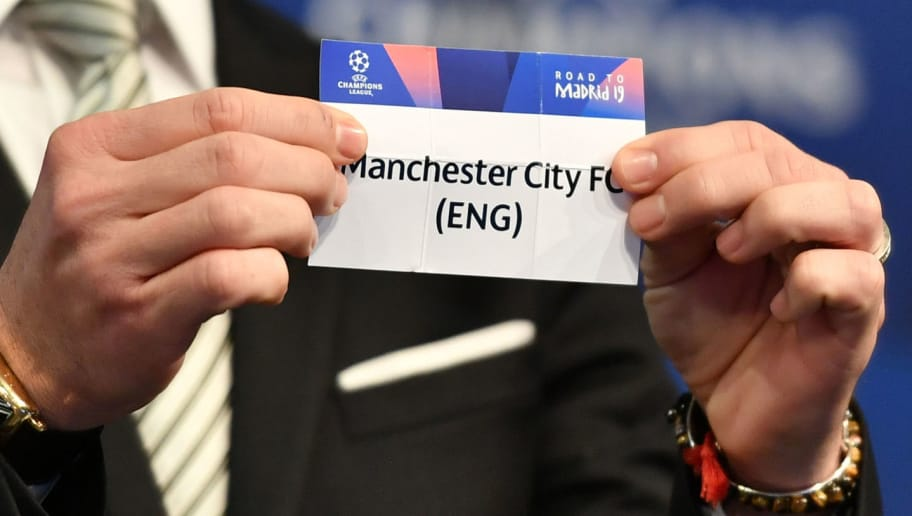 Former Spanish football player Luis Garcia shows the slip of Manchester City during the draw for the round of 16 of the UEFA Champions League football tournament at the UEFA headquarters in Nyon on December 17, 2018. (Photo by Fabrice COFFRINI / AFP)        (Photo credit should read FABRICE COFFRINI/AFP/Getty Images)