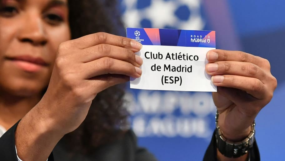 Former French football player Laura Georges shows the slip of Atletico Madrid during the draw for the round of 16 of the UEFA Champions League football tournament at the UEFA headquarters in Nyon on December 17, 2018. (Photo by Fabrice COFFRINI / AFP)        (Photo credit should read FABRICE COFFRINI/AFP/Getty Images)