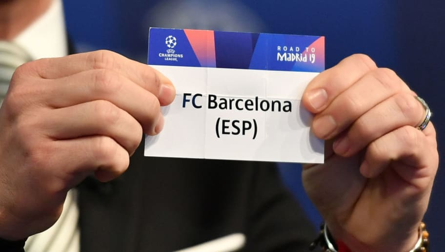 Former Spanish football player Luis Garcia shows the slip of FC Barcelona during the draw for the round of 16 of the UEFA Champions League football tournament at the UEFA headquarters in Nyon on December 17, 2018. (Photo by Fabrice COFFRINI / AFP)        (Photo credit should read FABRICE COFFRINI/AFP/Getty Images)