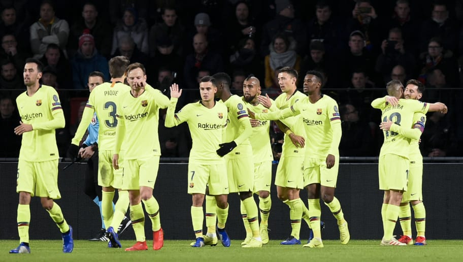 Barcelona's players celebrate after Barcelona's Argentine forward Lionel Messi (R) scored a goal during the UEFA Champions League football match between PSV Eindhoven and FC Barcelona at Philips stadium in Eindhoven on November 28, 2018. (Photo by JOHN THYS / AFP)        (Photo credit should read JOHN THYS/AFP/Getty Images)