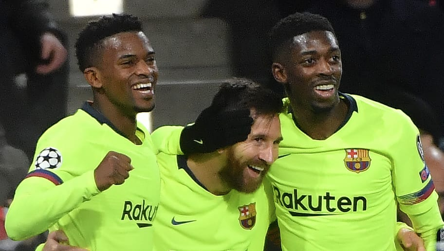 Barcelona's Argentine forward Lionel Messi (C) celebrates with teammates French forward Ousmane Dembele (R) and Portuguese defender Nelson Semedo (L) after scoring during the UEFA Champions League football match between PSV Eindhoven and FC Barcelona at Philips stadium in Eindhoven on November 28, 2018. (Photo by EMMANUEL DUNAND / AFP)        (Photo credit should read EMMANUEL DUNAND/AFP/Getty Images)