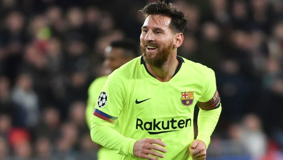 Barcelona's Argentine forward Lionel Messi reacts after his teammate Barcelona's Spanish defender Gerard Pique scores a goal during the UEFA Champions League football match between PSV Eindhoven and FC Barcelona at Philips stadium in Eindhoven on November 28, 2018. (Photo by EMMANUEL DUNAND / AFP)        (Photo credit should read EMMANUEL DUNAND/AFP/Getty Images)