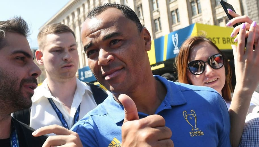 Brazilian former professional footballer Marcos Evangelista de Moraes, known as Cafu, (R) poses for a selfie picture at the fan zone in Kiev on May 24, 2018, ahead of the 2018 UEFA Champions League Cup final football match between Real Madrid and Liverpool FC next May 26 at the Olimpiyskiy Stadium. (Photo by Sergei SUPINSKY / AFP)        (Photo credit should read SERGEI SUPINSKY/AFP/Getty Images)