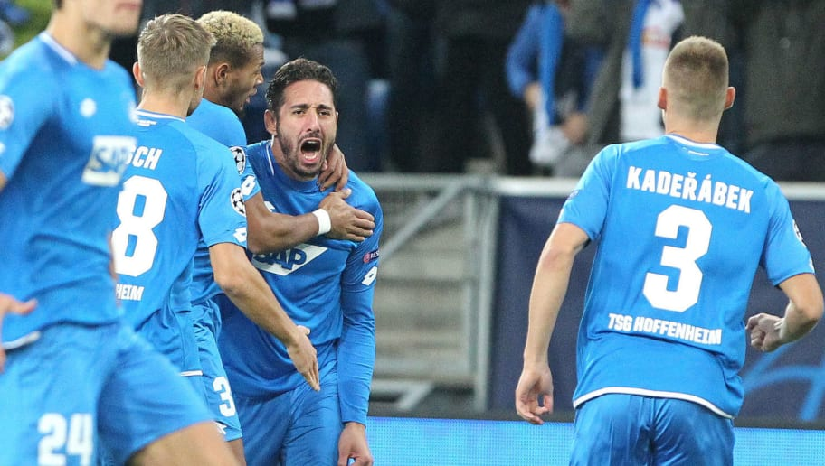 Hoffenheim's Algerian forward Ishak Belfodil (C) celebrates scoring the opening goal with his teammates during the UEFA Champions League group F football match between TSG 1899 Hoffenheim and Manchester City at the Rhein-Neckar-Arena in Sinsheim, southwestern Germany, on October 2, 2018. (Photo by Daniel ROLAND / AFP)        (Photo credit should read DANIEL ROLAND/AFP/Getty Images)