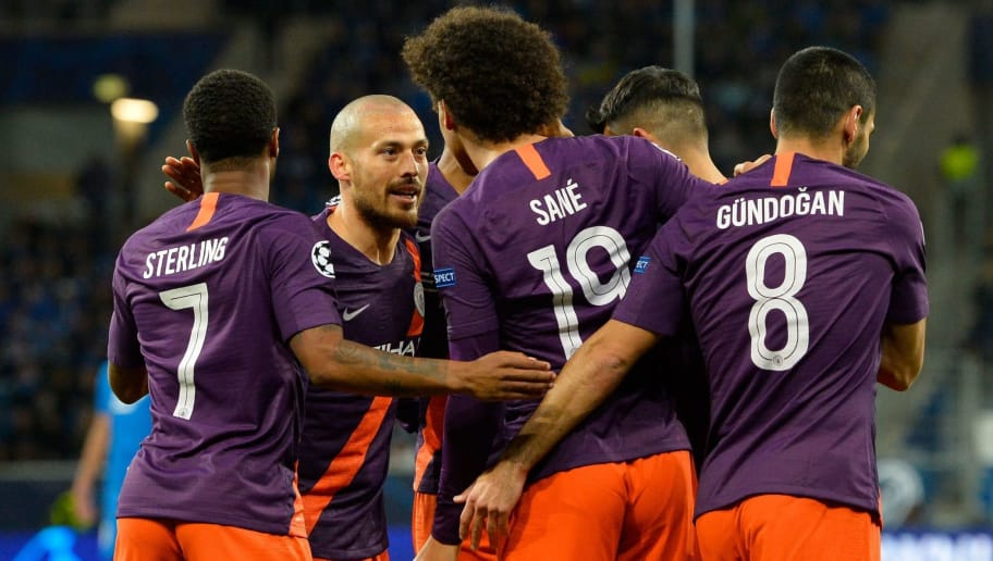Manchester City's Argentinian striker Sergio Aguero (2nd R) celebrates scoring the 1-1 goal with his team-mates during the UEFA Champions League group F football match between TSG 1899 Hoffenheim and Manchester City at the Rhein-Neckar-Arena in Sinsheim, southwestern Germany, on October 2, 2018. (Photo by Thomas KIENZLE / AFP)        (Photo credit should read THOMAS KIENZLE/AFP/Getty Images)