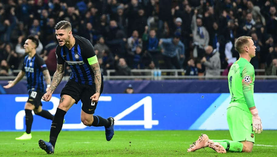 Inter Milan's Argentine forward Mauro Icardi (L) celebrates after scoring an equalizer during the UEFA Champions League group B football match Inter Milan vs Barcelona on November 6, 2018 at San Siro stadium in Milan. (Photo by Miguel MEDINA / AFP)        (Photo credit should read MIGUEL MEDINA/AFP/Getty Images)