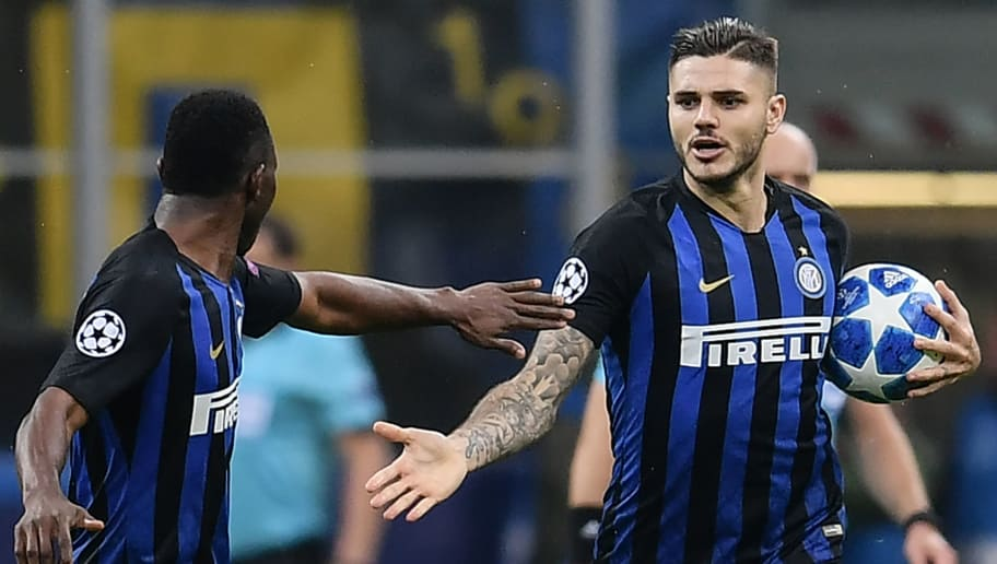 Inter Milan's Argentine forward Mauro Icardi (R) celebrates with Inter Milan's Ghanaian midfielder Kwadwo Asamoah afer scoring an equalizer during the UEFA Champions League group B football match Inter Milan vs Barcelona on November 6, 2018 at San Siro stadium in Milan. (Photo by Marco BERTORELLO / AFP)        (Photo credit should read MARCO BERTORELLO/AFP/Getty Images)