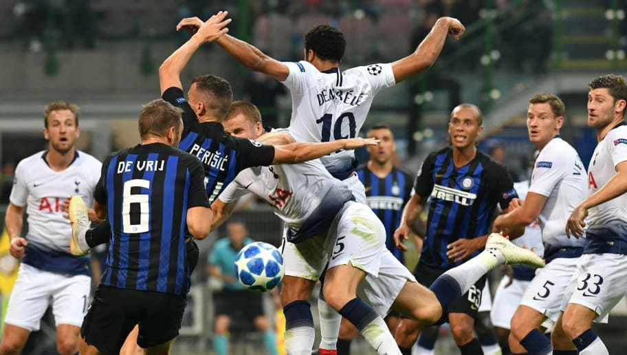 (From 3rdL) Inter Milan's Croatian midfielder Ivan Perisic, Tottenham's English midfielder Eric Dier and Tottenham's Belgian midfielder Moussa Dembele go for a header during the UEFA Champions League group stage football match Inter Milan vs Tottenham on September 18, 2018 at the San Siro stadium in Milan. (Photo by Andreas SOLARO / AFP)        (Photo credit should read ANDREAS SOLARO/AFP/Getty Images)