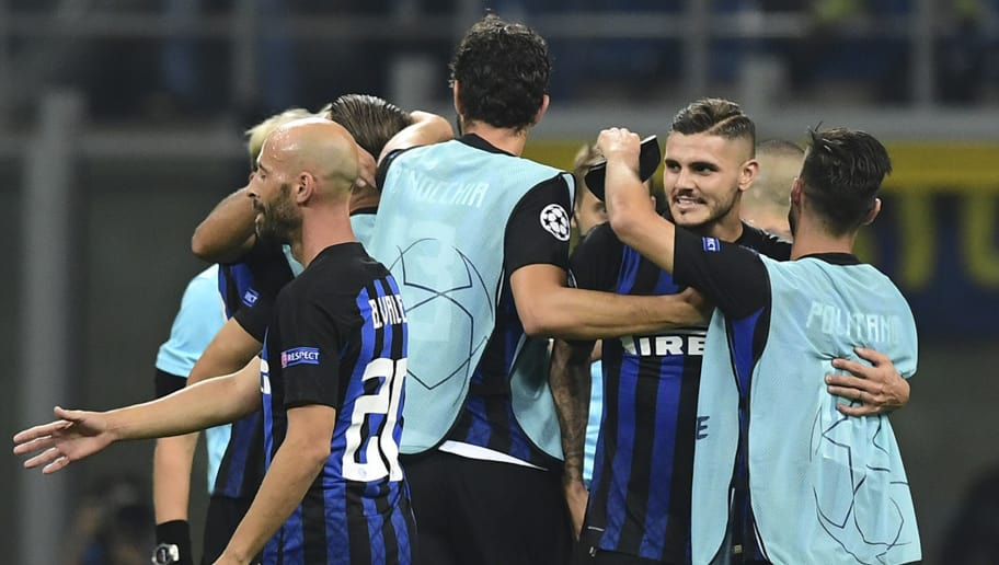 Inter Milan's Argentine forward Mauro Icardi (2ndR) celebrates with teammates after the UEFA Champions League group stage football match Inter Milan vs Tottenham on September 18, 2018 at the San Siro stadium in Milan. (Photo by Miguel MEDINA / AFP)        (Photo credit should read MIGUEL MEDINA/AFP/Getty Images)
