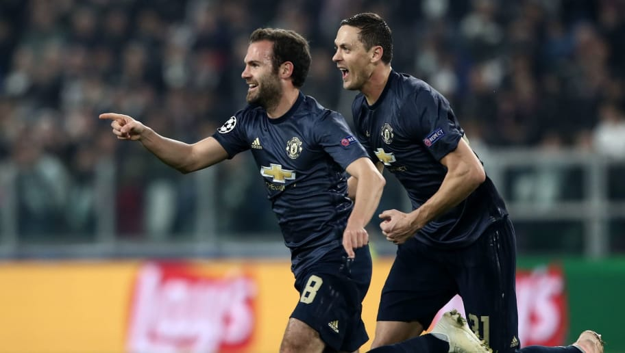 Manchester United's Spanish midfielder Juan Mata (L) celebrates with Manchester United's Serbian midfielder Nemanja Matic after scoring a free kick, equalizing during the UEFA Champions League group H football match Juventus vs Manchester United at the Allianz stadium in Turin on November 7, 2018. (Photo by Isabella BONOTTO / AFP)        (Photo credit should read ISABELLA BONOTTO/AFP/Getty Images)
