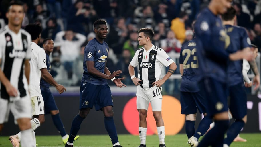 Manchester United's French midfielder Paul Pogba (L) recats next to Juventus' Argentine forward Paulo Dybala (R) during the UEFA Champions League group H football match Juventus vs Manchester United at the Allianz stadium in Turin on November 7, 2018. (Photo by Marco BERTORELLO / AFP)        (Photo credit should read MARCO BERTORELLO/AFP/Getty Images)