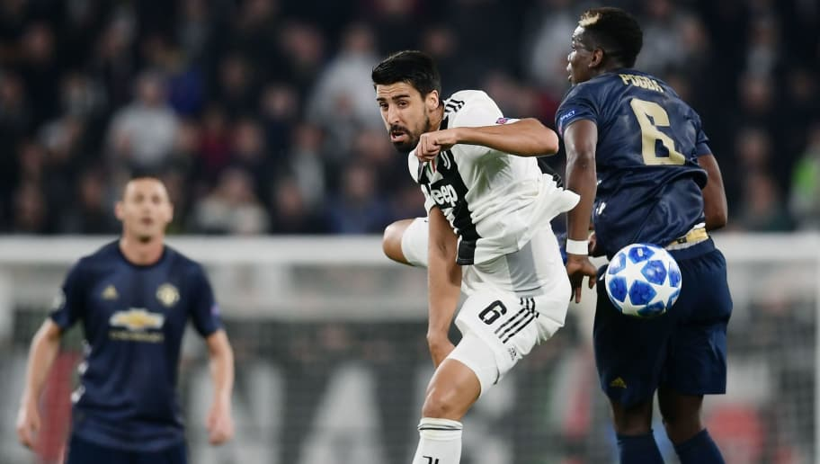 Juventus' German midfielder Sami Khedira (C) and Manchester United's French midfielder Paul Pogba (R) go for the ball during the UEFA Champions League group H football match Juventus vs Manchester United at the Allianz stadium in Turin on November 7, 2018. (Photo by Marco BERTORELLO / AFP)        (Photo credit should read MARCO BERTORELLO/AFP/Getty Images)