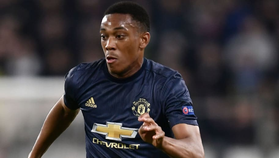 Manchester United's French striker Anthony Martial controls the ball during the UEFA Champions League group H football match Juventus vs Manchester United at the Allianz stadium in Turin on November 7, 2018. (Photo by Marco BERTORELLO / AFP)        (Photo credit should read MARCO BERTORELLO/AFP/Getty Images)