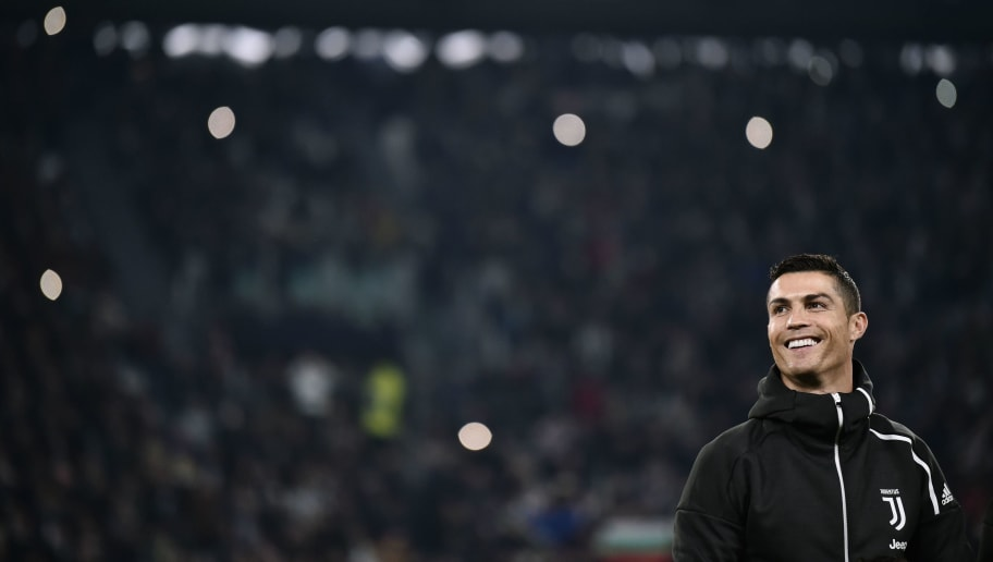 Juventus' Portuguese forward Cristiano Ronaldo smiles prior to the UEFA Champions League group H football match Juventus vs Manchester United at the Allianz stadium in Turin on November 7, 2018. (Photo by Marco BERTORELLO / AFP)        (Photo credit should read MARCO BERTORELLO/AFP/Getty Images)