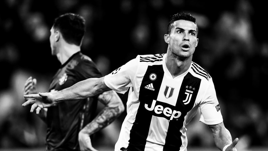 Juventus' Portuguese forward Cristiano Ronaldo celebrates after opening the scoring during the UEFA Champions League group H football match Juventus vs Manchester United at the Allianz stadium in Turin on November 7, 2018. (Photo by Marco BERTORELLO / AFP) / BLACK AND WHITE        (Photo credit should read MARCO BERTORELLO/AFP/Getty Images)