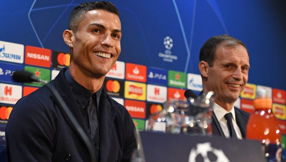 Juventus' Portuguese striker Cristiano Ronaldo (L) and Juventus' manager Massimiliano Allegri (R) attend a press conference at Old Trafford in Manchester, north west England on October 22, 2018, ahead of their UEFA Champions League group H football match against Juventus on October 23. (Photo by Oli SCARFF / AFP)        (Photo credit should read OLI SCARFF/AFP/Getty Images)