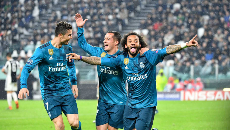 Real Madrid's Brazilian defender Marcelo (R) celebrates after scoring with Real Madrid's Spanish midfielder Lucas Vazquez and Real Madrid's Portuguese forward Cristiano Ronaldo (L) during the UEFA Champions League quarter-final first leg football match between Juventus and Real Madrid at the Allianz Stadium in Turin on April 3, 2018. / AFP PHOTO / Alberto PIZZOLI        (Photo credit should read ALBERTO PIZZOLI/AFP/Getty Images)