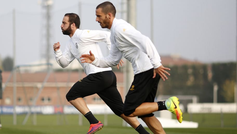 Juventus' forward Gonzalo Higuain from Argentina (L) and Juventus' defender from Italy Leonardo Bonucci take part in a training session on the eve of the UEFA Champions League football match Juventus Vs Olympique Lyonnais on November 1, 2016 at the 'Juventus Training Center ' in Vinovo, near Turin.  / AFP / MARCO BERTORELLO        (Photo credit should read MARCO BERTORELLO/AFP/Getty Images)