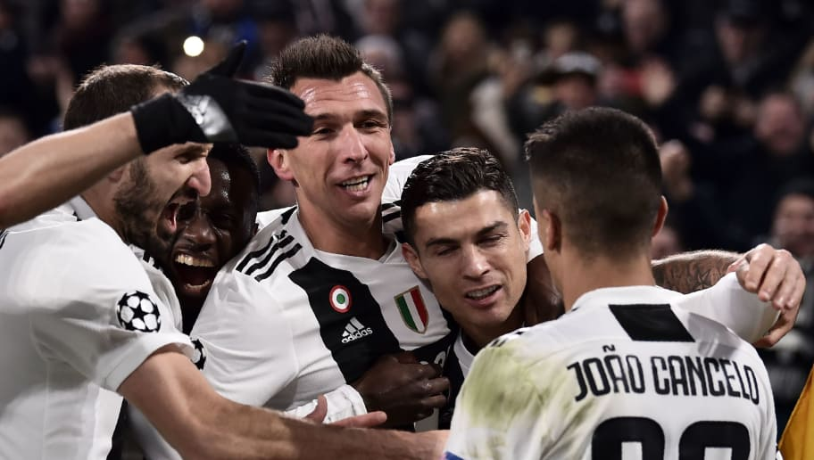 Juventus' Croatian forward Mario Mandzukic (C-L) celebrates with (From L) Juventus' Italian defender Giorgio Chiellini, Juventus' French midfielder Blaise Matuidi, Juventus' Portuguese forward Cristiano Ronaldo and Juventus' Portuguese defender Joao Cancelo after opening the scoring during the UEFA Champions League group H football match Juventus vs Valence on November 27, 2018 at the Juventus stadium in Turin. (Photo by Marco BERTORELLO / AFP)        (Photo credit should read MARCO BERTORELLO/AFP/Getty Images)