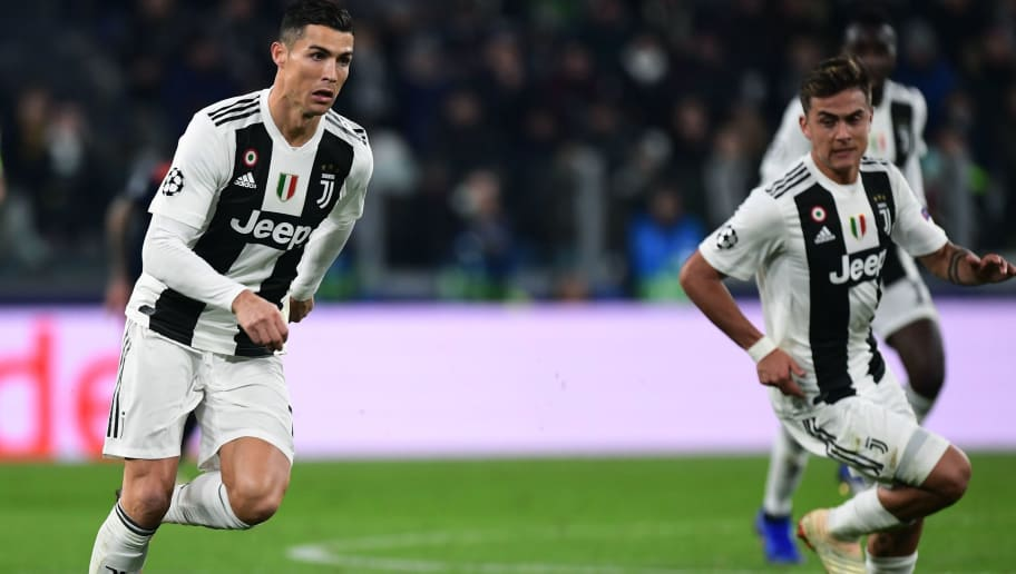 Juventus' Portuguese forward Cristiano Ronaldo (L) controls the ball next to Juventus' Argentine forward Paulo Dybala during the UEFA Champions League group H football match Juventus vs Valence on November 27, 2018 at the Juventus stadium in Turin. (Photo by Miguel MEDINA / AFP)        (Photo credit should read MIGUEL MEDINA/AFP/Getty Images)