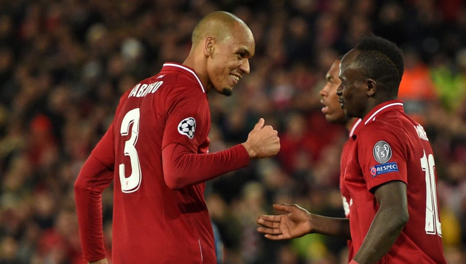 Liverpool's Senegalese striker Sadio Mane (R) celebrates with Liverpool's Brazilian midfielder Fabinho (L) after scoring their fourth goal during the UEFA Champions League group C football match between Liverpool and Red Star Belgrade at Anfield in Liverpool, north west England on October 24, 2018. (Photo by Oli SCARFF / AFP)        (Photo credit should read OLI SCARFF/AFP/Getty Images)