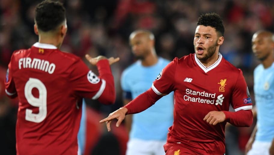 Liverpool's English midfielder Alex Oxlade-Chamberlain (R) celebrates with Liverpool's Brazilian midfielder Roberto Firmino for scoring the team's second goal during the UEFA Champions League first leg quarter-final football match between Liverpool and Manchester City, at Anfield stadium in Liverpool, north west England on April 4, 2018. / AFP PHOTO / Anthony Devlin        (Photo credit should read ANTHONY DEVLIN/AFP/Getty Images)