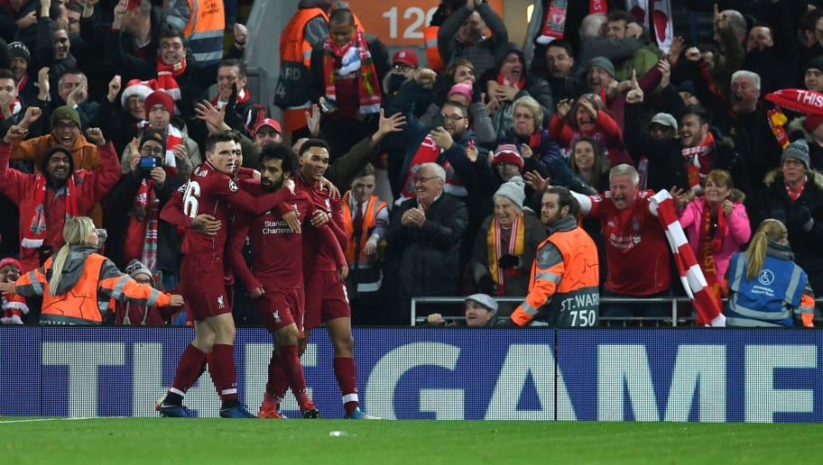 Liverpool's Egyptian midfielder Mohamed Salah (C) celebrates scoring the opening goal during the UEFA Champions League group C football match between Liverpool and Napoli at Anfield stadium in Liverpool, north west England on December 11, 2018. (Photo by Paul ELLIS / AFP)        (Photo credit should read PAUL ELLIS/AFP/Getty Images)