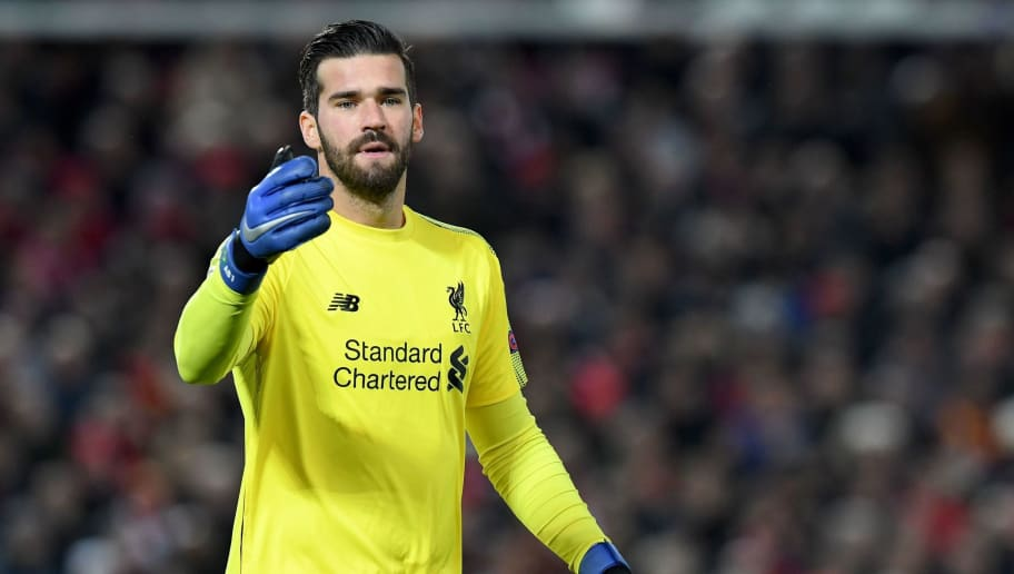 Liverpool's Brazilian goalkeeper Alisson Becker gestures during the UEFA Champions League group C football match between Liverpool and Napoli at Anfield stadium in Liverpool, north west England on December 11, 2018. (Photo by Paul ELLIS / AFP)        (Photo credit should read PAUL ELLIS/AFP/Getty Images)